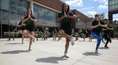 dance company pose as the drumline plays a jungle jingle.